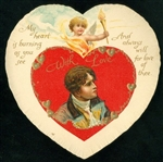 "Nister - Double Heart Valentine with Winged Cupid Holding Torch, ""My Heart is Burning As You See."""