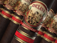 Pictured is a cigar with a band that has a horse and an indian on it, also has a red and gold band under it