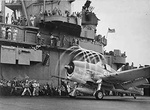 Photo of a Grumman F6F Hellcat fighter operating from the deck of the carrier USS Lexington during World War 2.