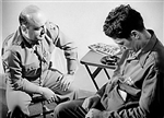A serviceman undergoes hypnosis during treatment