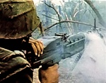 Photo of a Marine operating an M60 machine gun in the Vietnam war.