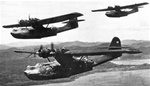 Photo of Black Cat PBY  Navy bombers on a night mission against Japanese shipping in the Pacific during World War 2.