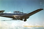 Color photo of a Navy North American SNJ Advance trainer taken from the film Naval Aviation Cadet.