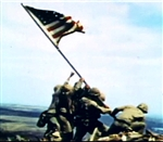 Marines raise the American flag atop Mount Suribachi on Iwo Jima