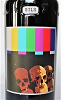 750 ml bottle of 2012 Sine Qua Non Touche Estate Syrah from the Eleven Confessions Vineyard produced and bottled in Ventura California by Manfred Krankl scoring 100 points from Robert Parker's Wine Advocate