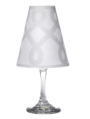 Scroll pattern translucent paper white wine glass shades.  Available in silver glitter and gold.  Made in the USA.
