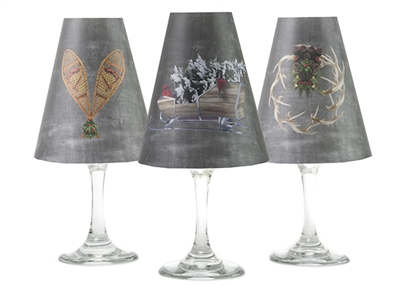 Set of 6 coordinating sleigh, snowshoes, and wreath pattern translucent paper white wine glass shades by di Potter.  Made in the USA