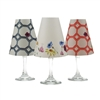 Set of 6 coordinating roses, leaves and zinnias pattern translucent paper white wine glass shades by di Potter.  Simple add a tea light to a wine glass to create simple table decor.  Made in the USA