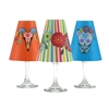 Set of 6 coordinating Day of the Dead holiday translucent paper white wine glass shades by di Potter.  Simple add a tea light to a wine glass to create simple table decor.  Made in the USA