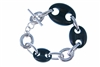 The classic Chain link Bracelet has been updated with hand carved pieces of multi-sized Black Ebony links added to the design. 925 Sterling Silver with Toggle Clasp. Made in Italy by Claudio Faccin