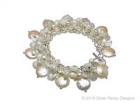 A stunning White Sapphire & Pearl Bracelet by Silver Pansy. Hand crafted in the U.S., this designer Bracelet features lustrous White Fresh Water Coin Pearls, mixed with Keshi Pearls & White Sapphire Gemstones. 925 Sterling Silver with a Toggle clasp.