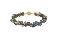 "Hand Crafted, this Bracelet features uniquely cut ""Cubed"" Labradorite Gemstones, alternating with clusters of brilliant, faceted, London Blue Topaz Gemstones. These two Gemstones compliment each other  perfectly. Gold Filled Sterling Chain & Latch."