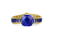 Ziio's small Armonia Tennis Bracelet features a large Lapis Gemstone at the center with Blue Quartz Gemstones on the band. Gold Murano Glass seed Beads outline the band. 925 Sterling Silver Button Closure, adjustable in length.