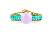 Ziio's Armonia Tennis Bracelet features a large Violet Amethyst Gemstone at the center with Blue Turquoise Gemstones on the band. Gold Murano Glass seed Beads outline the band. 925 Sterling Silver Button Closure, adjustable in length.