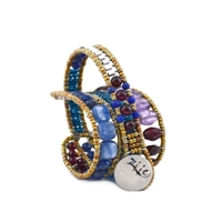 Ziio's new Evolution Bracelet is designed to fit any wrist, from child to adult. With an innovative fastening technique, it becomes a universal model for all. Hand crafted in Blue Kyanite. Lapis, Purple Amethyst & Garnet gemstones.