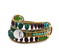 Ziio's new Evolution Bracelet is designed to fit any wrist, from child to adult. With an innovative fastening technique, it becomes a universal model for all. Hand crafted in Green Malachite, Jade, Peridot & Red Garnet gemstones.