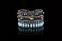 Ziio's Liberty Cuff Bracelet done in dark Grey Pearls, Chrysocolla, and Azurite gemstones  accented with the Sky Blue Agate Beads. Hand crafted on stainless steel wire with Murano Glass seed beads. Sterling Silver button closure,