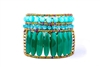 A vibrant statement Cuff Bracelet by Ziio. Large cylinders of Green Onyx Gemstone are accented by Blue Turquoise & Zircon Gemstones. Multi-colored Murano Glass Seed Beads, strung on Stainless Wire, outline & frame the design. Hand-crafted in Italy.