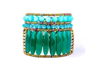 A vibrant statement Cuff Bracelet by Ziio. Large cylinders of Green Onyx Gemstone are accented by Blue Amazonite & Aventurine Gemstones. Multi-colored Murano Glass Seed Beads, strung on Stainless Wire, outline & frame the design. Hand-crafted in Ital