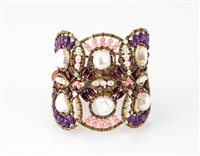 From Ziio's Permanent Collection, this statement Cuff Bracelet is a head turner. Large White Freshwater Pearls are the focus of this design, accented by Purple Amethyst & Pink Howlite Gemstones. Silver and Murano Glass Beads. Sterling Silver Button Closur