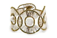 From Ziio's Permanent Collection, this Cosmic Cuff Bracelet is perfect for those who want unique. Large White Baroque Freshwater Pearls are the focus of this design, accented by White Mother of Pearl Beads, Silver beads & Onyx Gemstones. Hand crafted in
