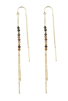 These stunning threader Earrings frame your face with movement and sparkle. Wear the natural ruby and sapphire gemstones to bring confidence and calm to your next big event. /\ Ruby/sapphire, gold coated pyrite and vermeil chains, 14K gold fill threaders