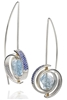 INSPIRO CERES SPIRAL EARRING WITH AN AQUAMARINE GEMSTONE AT THE CENTER AND  LAB CREATED BLUE SAPPHIRES IN THE SPIRAL. MADE OF ARGENTIUM SILVER, TO PREVENT TARNISHING. By Martha Seeley Designs