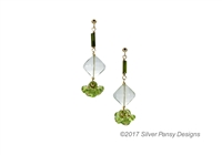 A unique drop Earring hand crafted in the U.S. by Silver Pansy. Dark Green Tourmaline beads lead the way with a diamond drop of soft Green Praisiolite, followed by a Green Peridot Gemstone. Gold Filled Sterling Silver wire & Posts.