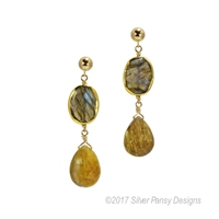 Multi-color bezel set Labradorite Gemstones hold a Golden Rutilated Quartz Gemstone drop. The warmth & shimmer of complimenting Gemstones will remind you of a Fall Sunset. Made in the U.S. by Silver Pansy. Gold Filled Sterling Silver Posts and chain.