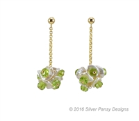 These unique, hand crafted, drop Earrings feature a cluster of Peridot Gemstones with White Keshie Pearls - all for the fun of it. Made in the U.S. by Silver Pansy. Gold Filled Sterling Silver chain & Posts.
