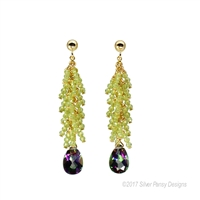 Beautiful, hand crafted drop Earrings. Green Peridot Gemstones create a feather affect above the Mystic Topaz Gemstone drop - filled with the reflective colors of the Sea. Made in the U.S. by Silver Pansy. Gold Filled Sterling wire & posts.