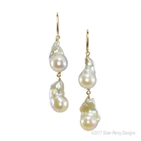 "Love the Baroque Pearl? This White, Double Drop, Baroque Pearl Chandelier Earring is sure to satisfy. Made in the U.S. by Silver Pansy, they are done in White Sterling Silver. Hooks. No two pairs are alike. Length 2 3/4"", Width 1/2"""