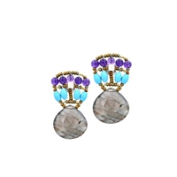 The Heart Victoire Earring in Blue. A large faceted, tear drop Labradorite Gemstone descends from a beaded post of Purple Amethyst & Turquoise Gemstones. Framed on stainless steel wire with Murano Glass seed beads. 925 Sterling Silver Post. Length 1 1/2""