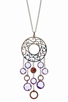 The 18k Gold is cut like lace work in this unique designer Pendant Necklace. From a circular Gold, open work Pendant descends seven Bezel set, faceted Purple Amethyst Gemstones. Set your self apart with this Limited Edition Piece from Legi. Made in Italy.