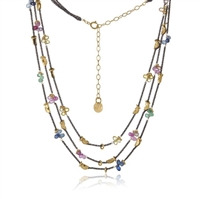 "Petal-shaped multi-colored Sapphire and Emerald tear drop Gemstone clusters on three strands of Oxidized diamond cut Sterling Silver chain with 14k gold-plated half moon details. 16""-18"" adjustable. Made in San Francisco by Mabel Chong."