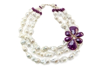 Beautiful Triple Strand White Baroque Pearl Necklace with a large, attached, Flower Pendant in African Rubies with Diamond accents. This designer Necklace was made in Italy by Rajola. 18K Yellow Gold. One of a kind.