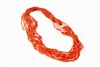 Stunning, multi-strand, Sciacca Coral Necklace by Rajola. Coral Nugget Necklace has a large, hand carved, Carnelian Medallion that holds the strands. No Latch. Sciacca Coral is 2,000 to 5,000 year old petrified Coral.