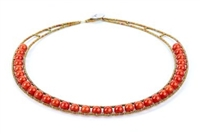 From Ziio's Permanent Collection, this single strand simulated Coral Necklace is a classic with Italian style. Framed with golden Murano Glass seed beads, this piece has a fresh, new look and can easily be dressed up or down. Made in Italy