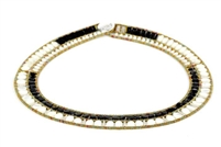 A beautiful & classic Black & White Necklace by Ziio. Mother of Pearl & Black Onyx are outlined by small seed beads of Murano glass. Stainless steel wire & Sterling silver button closure - adjustable in length. Made in Italy.