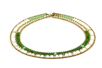 A beautiful & classic Green & White Necklace by Ziio. Mother of Pearl & Green Jade are outlined by small seed beads of Murano glass. Stainless steel wire & Sterling silver button closure - adjustable in length. Made in Italy.