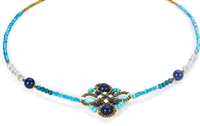Ziio's Knott Necklace in a beautiful medley of Blue Gemstones - Lapis, Iolite & Blue Zircon. A Flower Knott at the center is the focus of this piece. Hand crafted in Italy with Murano Glass seed beads on stainless steel wire.