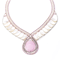 "Beaded Pendant has polished Pink Rhodochrosite Gemstone accented with Silver Beads, Mother of Pearl and White Fresh Water Pearls. Soft hues make this piece noticeable. Hand crafted in Italy. Sterling Button Closure. Adjustable length 18"" to 16""."