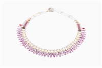 From Ziio's Mistinquett Collection ,this Mother of Pearl Necklace is like no other. A single row of Pearl Beads is complimented by a fan like effect of Pink Bohemian Glass Beads and accented by Murano Glass Beads.