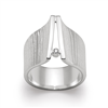 925 Sterling Silver Ring by Bastian. With a modern, contemporary feel the wide band has a textured finish with an elevated, polished front that holds a White Diamond, 0.02cts. Size 7. Rhodium plated. Made in Germany.