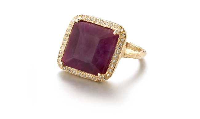 Known for her custom, one-of-a-kind pieces, this Ruby Ring by DyanneBelle is one to covet. The emerald cut African Ruby (purple/red in color - aprox 22ctw)) is stunning and set off by a pave of 0.36ctw White Diamonds framing it. Made in 14k Gold. Size 7.