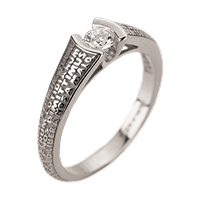 This Solitaire Diamond Ring is embellished with the Lords Prayer in relief around the band. Thanks to the precious gold, the Latin words stand out clearly protecting the diamond. 18k White Gold