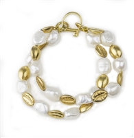 This Bracelet features White Baroque Freshwater Pearls alternatinf with Gold plated silver Nuggets. Double Strand with a large lobster clasp. Made in Italy by Anticoa. Length 8 1/4""