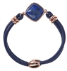 "A beautiful Lapis Cabochon is the focus of this Bracelet by Bronzallure. The band is a double row of Navy leather wrapped cord.  Made in Milan, finished in 18K Golden Rose plating. Magnetic Closure. Length 7 1/2"", Cabochon 3/4"", Band 3/8"" wide."