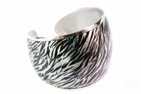 This wide, 925 Sterling Silver Cuff Bracelet has a two-tone Enameled overlay. The finish is a silver and black Zebra look. A very subtle Animal print that adds a contemporary style. Made in Italy by Claudio Faccin. Size Medium
