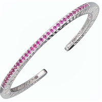 Narrow stacking Bangle. Solid Sterling Slv inlaid with 33 (2ct) 1.7mm Pink Rhodolite Garnet Gemstones. Beautiful open work design along the sides. Designer Martha Seely signature interlocking spirals. Hinged to allow for a good fit. 4mm Wide. Size Med.